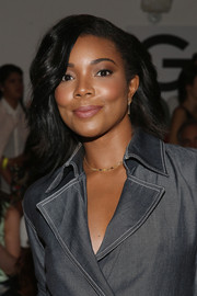 Gabrielle Union Wade styled her hair with subtle waves and side-swept bangs for the Wes Gordon fashion show.