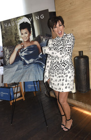 Kris Jenner celebrated her Haute Living cover wearing a long-sleeve black-and-white print dress by Louis Vuitton.