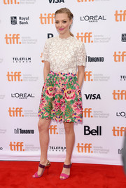 Amanda Seyfried amped up the girly vibe in a Valentino cocktail dress with a white lace bodice and a colorful floral-embroidered skirt during the premiere of 'While We're Young.'