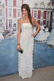 Bianca Brandolini mixed things up by pairing a loose fishtail braid with a Valentino gown. Chic yet casual—we love it!