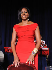 Mrs. O showed off her sparkling bangle bracelets while co-hosting the White House Correspondents Dinner.