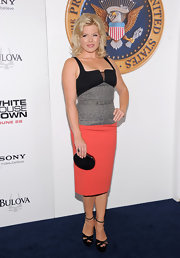 Megan Hilty wore a fitted, color-blocked dress that featured a leopard-print bodice and a coral skirt.
