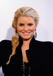 Jessica Simpson opted for a relaxed side braid while attending a conference in California. Sparkling earrings completed her look.