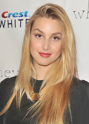 At her fall 2012 fashion show, Whitney Port wore a glossy muted cool red lipstick.
