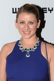 Lo added some sparkle and shine to her classic dress with this emerald green statement necklace.
