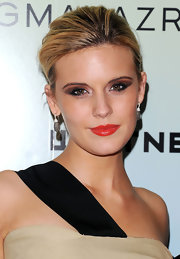 Maggie showed off her dramatic makeup with a sleek low bun.