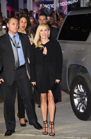 Reese Witherspoon arrived for the 'Wild' premiere wearing a structured black coat over an LBD.