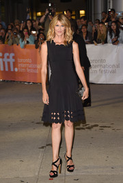 Laura Dern added a bit of glitter via an Emm Kuo box clutch.