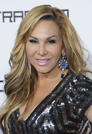 Adrienne Maloof injected a bit of color to her neutral ensemble with a pair of blue dangling decorative earrings.