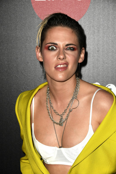 Kristen Stewart bared her white bra underneath her open jacket at the Pioneer Dinner honoring Elizabeth Banks.