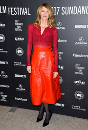 Laura Dern teamed her top with a Bottega Veneta leather midi skirt in a brighter shade of red.
