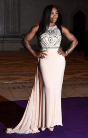 Serena Williams cut a regal figure in a pale pink gown with a beaded bodice during the Wimbledon champions dinner.