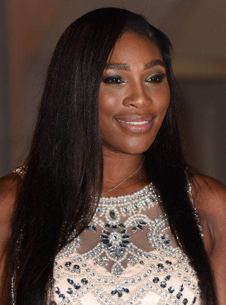Serena Williams wore her hair down in a sleek straight style during the Wimbledon champions dinner.