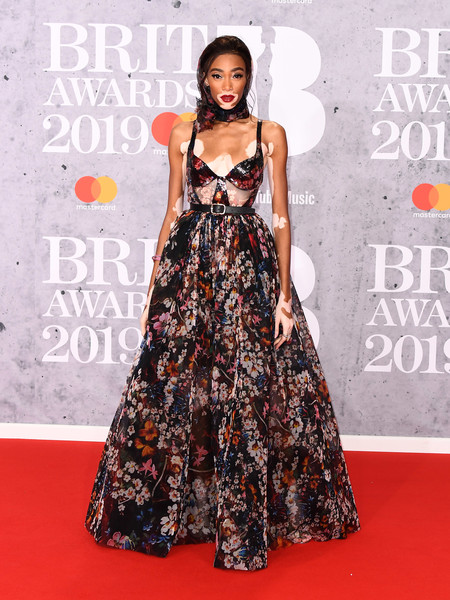 Winnie Harlow Corset Dress [red carpet,clothing,carpet,dress,fashion model,premiere,fashion,flooring,gown,a-line,red carpet arrivals,winnie harlow,brit awards,london,england,the o2 arena]