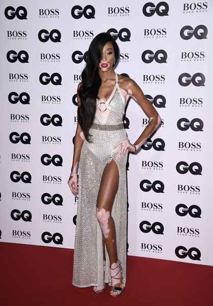 Winnie Harlow Sheer Dress [fashion model,clothing,dress,shoulder,red carpet,premiere,carpet,fashion,cocktail dress,joint,winnie harlow,gq men of the year awards,england,london,tate modern,red carpet arrivals]