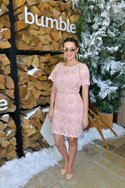 Carly Steel went the sweet route in a pink eyelet mini dress when she attended Winter Bumbleland.