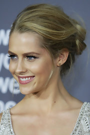 Teresa Palmer attended the Australian premiere of 'Wish You Were Here' wearing her hair in a casually twisted updo.