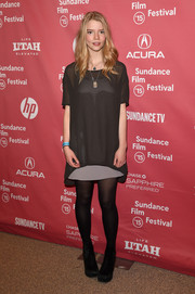 Anya Taylor-Joy styled her look with black suede ankle boots.