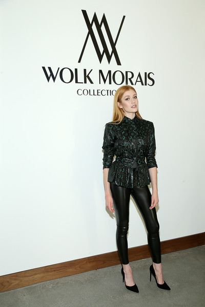 Katherine McNamara teamed a belted print blouse with black leather leggings for the Wolk Morais Collection 7 fashion show.