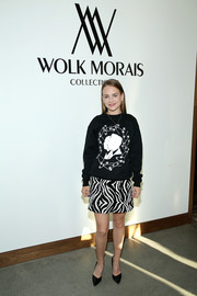 Britt Robertson teamed her top with a zebra-sequined mini skirt.