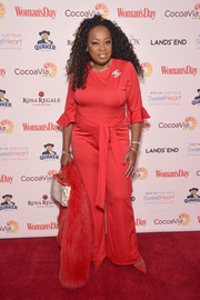 Star Jones matched her jumpsuit with a pair of red pumps.