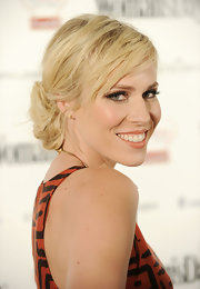 Natasha Bedingfield rocked a loose bun at the nape of her neck. Textured bangs swept across her glowing skin.