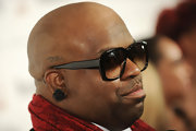 Cee-Lo Green gave his dapper look an interesting touch with black rose stud earrings.