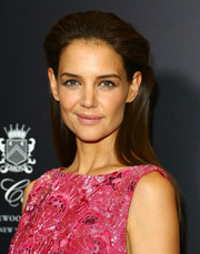 Katie Holmes wore her hair straight and slicked back with lots of volume at the top during the 'Woman in Gold' premiere.