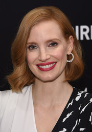 Jessica Chastain polished off her look with a pair of diamond hoops by Piaget.