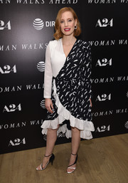 Jessica Chastain attended the New York screening of 'Woman Walks Ahead' wearing a black-and-white ruffle-hem wrap dress by Givenchy.