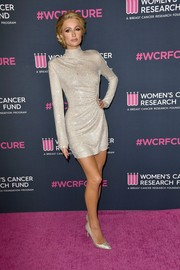 Paris Hilton shimmered in a micro-beaded silver mini dress at the 2020 Unforgettable Evening Gala.