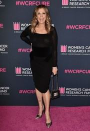 A pair of black mesh pumps with silver toe caps polished off Rita Wilson's outfit.