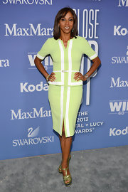 Holly Robinson wore a lime green blocked sheath dress to the Women in Film Crystal + Lucy Awards.