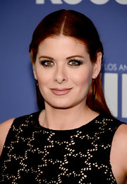 Debra Messing chose a half updo for her look at the Lucy + Crystal Awards.