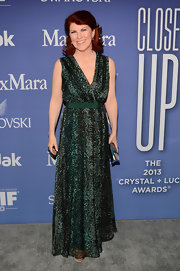 Kate Flannery sported a green V-neck print dress at the Crystal + Lucy Awards.