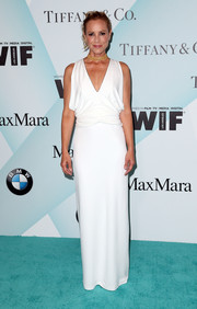 Maria Bello attended the Crystal + Lucy Awards looking like a Greek goddess in her draped white column dress.