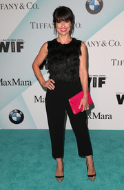 Constance Zimmer sported a black feather-bodice jumpsuit by Max Mara at the Crystal + Lucy Awards.