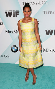 Regina King looked very summery in a yellow and green print dress during the Crystal + Lucy Awards.