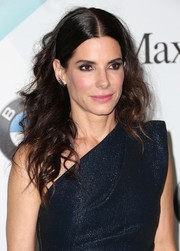 Sandra Bullock wore her hair sleek and center-parted at the top and curly down the ends during the Crystal + Lucy Awards.