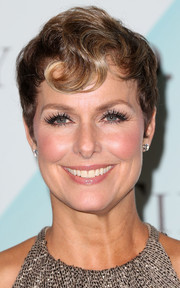 Melora Hardin styled her hair into a short 'do with a kiss-curl for the 2015 Crystal + Lucy Awards.