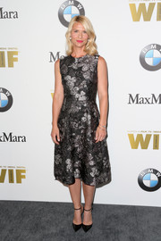 Claire Danes chose simple black ankle-strap pumps to pair with her dress.