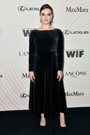 Katherine Langford went for understated elegance in a long-sleeve black velvet dress by Max Mara at the 2018 Crystal + Lucy Awards.