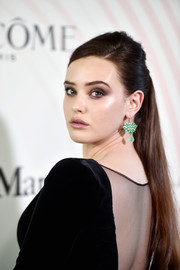 Katherine Langford added a pop of color with a pair of green chandelier earrings.