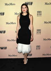 Lake Bell dolled up in a black Marina Moscone dress with a white feather hem for the 2019 Women in Film Gala.