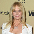 Hairstyles For Women With Fine Hair: Rosanna Arquette's Layered Cut With Curtain Bangs