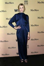 Elizabeth Debicki kept it minimal in a high-neck navy column dress by Max Mara at the 2019 Women in Film Gala.