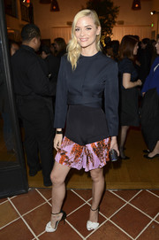 Jaime King teamed her jacket with a unique pair of print shorts, also by Christian Dior.