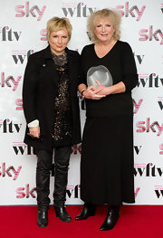 Jennifer Saunders' black pea coat looked oh-so-chic layered over a glittery blouse.
