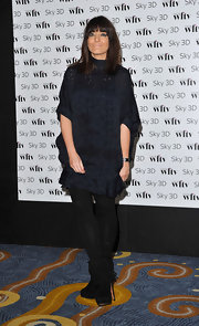 Claudia Winkleman looked fresh in fringe-embellished black suede ankle boots.