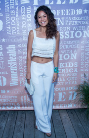 Emmanuelle Chriqui rounded out her all-white ensemble with a simple leather clutch.